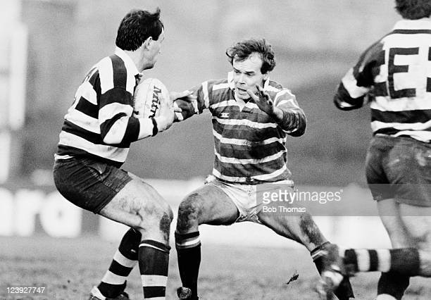 Simon Hogg of Bristol is tackled by Leicester centre Clive Woodward during the John Player Special Cup 3rd round match at Welford Road in Leicester...