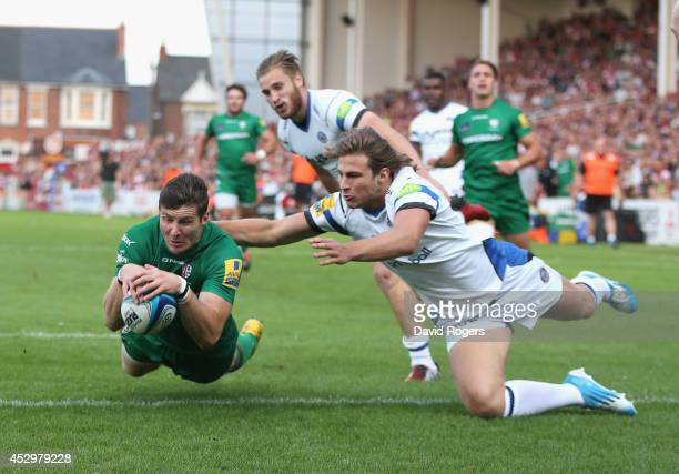 Simon Hunt of London Irish dives over for a try against Bath during the Premiership Rugby 7's Series at Kingsholm Stadium on July 31 2014 in...