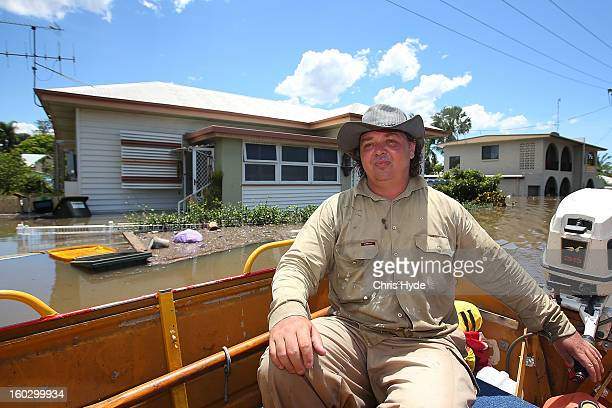 Simon Jackson sits in his boat outside his flooded house Simon has been using his boat to rescue people as parts of southern Queensland experiences...
