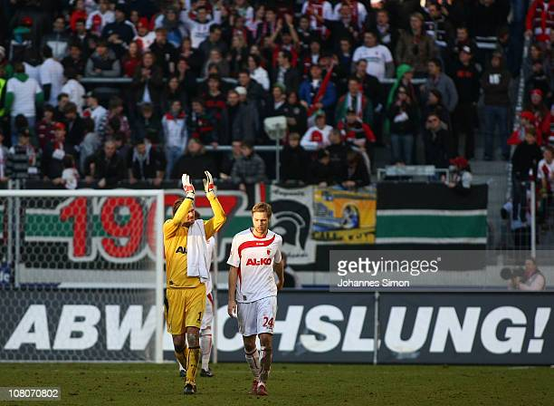 Simon Jentzsch and Daniel Brinkmann of Augsburg celebrate with teammate Moritz Leitner after scoring 20 during the Second Bundesliga match between FC...