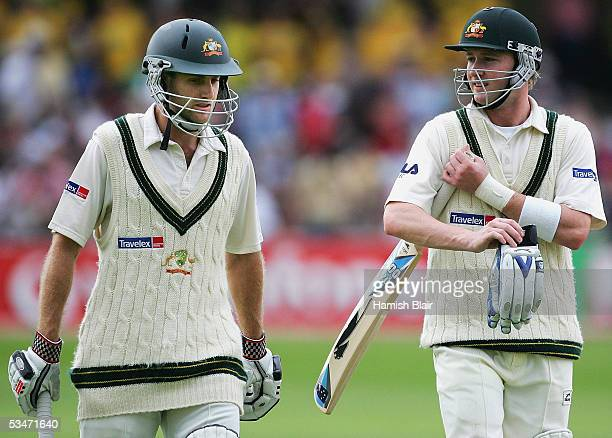 Simon Katich L and Michael Clarke of Australia leave the field at the close of play during day three of the Fourth npower Ashes Test between England...