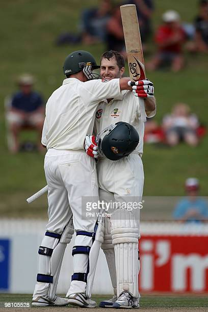 Simon Katich of Australia celebrates his century with Michael Hussey during day three of the Second Test Match between New Zealand and Australia at...