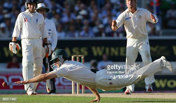Simon Katich of Australia dives after the ball during day one of the Fifth npower Ashes Test between England and Australia played at The Brit Oval on...