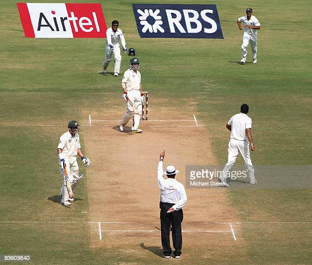 Simon Katich of Australia is given out for 102, lbw off the bowling of Zaheer Khan of India, during day three of the Fourth Test match between India...