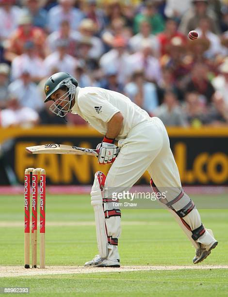 Simon Katich of Australia is hit by a short pitched ball by Andrew Flintoff of England during day three of the npower 1st Ashes Test Match between...