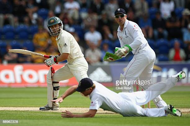 Simon Katich of Australia is stopped by a diving Paul Collingwood of England during day three of the npower 1st Ashes Test Match between England and...