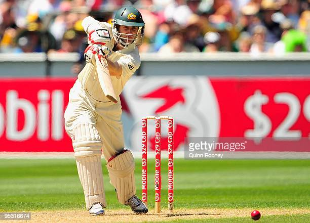 Simon Katich of Australia plays an off drive during day one of the First Test match between Australia and Pakistan at Melbourne Cricket Ground on...