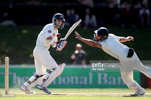 Simon Katich of Australia puts the ball past the hands of BJ Watling of New Zealand during day three of the Second Test Match between New Zealand and...
