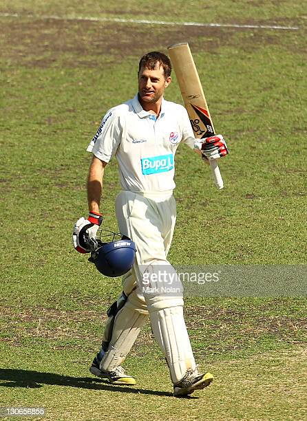 Simon Katich of the Blues celebrates his century during day four of the Shieffield Shield match between the New South Wales Blues and the Victoria...