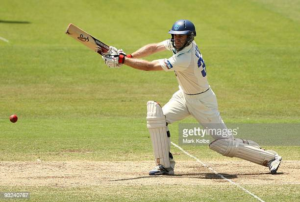 Simon Katich of the Blues drives through cover during day four of the Sheffield Shield match between the New South Wales Blues and the Tasmanian...