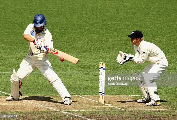 Simon Katich of the Blues square cuts on his way to a centrury during day one of the Pura Cup match between the Victorian Bushrangers and the New...