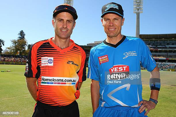 Simon Katich of the Scorchers and Johan Botha of the Strikers pose after the coin toss during the Big Bash League match between the Perth Scorchers...