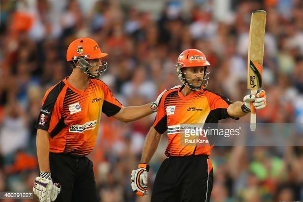 Simon Katich of the Scorchers celebrates his half century with Mitch Marsh during the Big Bash League match between the Perth Scorchers and Sydney...