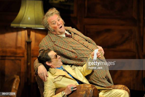 Simon Keenlyside as Ford and Bryn Terfel as Sir John Falstaff in the Royal Opera's production of Giuseppe Verdi's Falstaff directed by Robert Carsen...