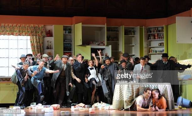 Simon Keenlyside as Ford Frederic Antoun as Fenton and Anna Prohaska as Nannetta with artists ofthe company in the Royal Opera's production of...
