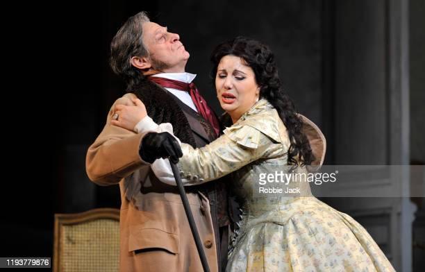 "Simon Keenlyside as Giorgio Germont and Hrachuhi Bassenz as Violetta Valery in The Royal Opera's production of Giuseppe Verdi's ""La Traviata""..."