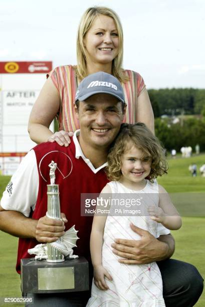 Simon Khan holding his trophy with his wife Karen and niece Eve after winning the Wales Open at Celtic Manor Newport Wales Khan ranked 255th in the...