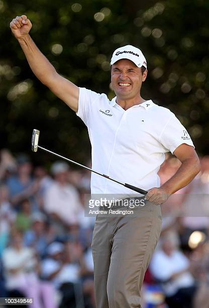 Simon Khan of England celebrates holing a birdie putt on the 18th green during the final round of the BMW PGA Championship on the West Course at...