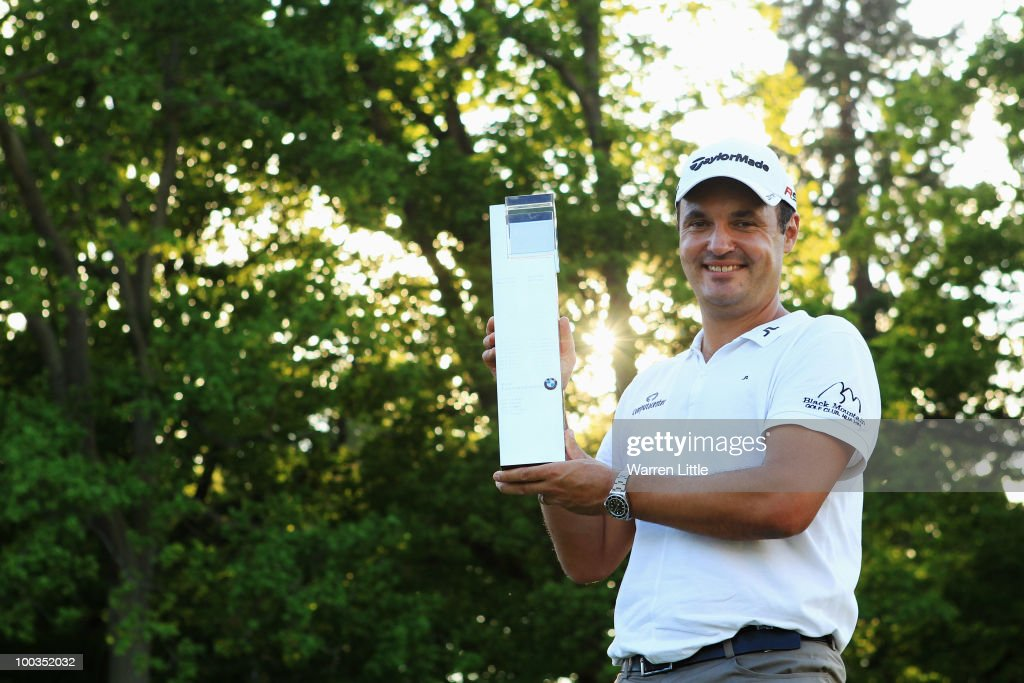 Simon Khan of England celebrates with the trophy following his victory in the BMW PGA Championship on the West Course at Wentworth on May 23, 2010 in Virginia Water, England.