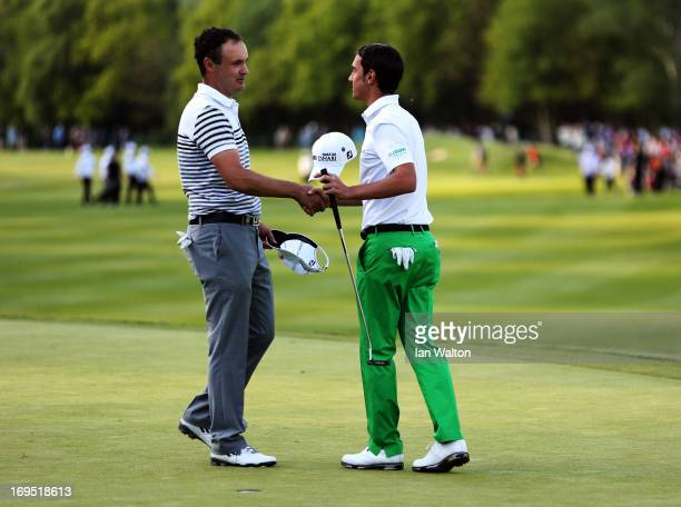 Simon Khan of England congratulates Matteo Manassero of Italy after he claims victory on the eighteenth green after the fourth playoff hole during...