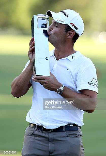Simon Khan of England kisses the trophy following his victory at the end of the final round of the BMW PGA Championship on the West Course at...