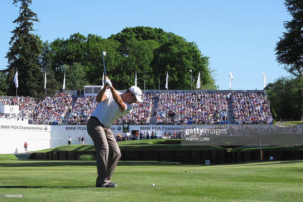 Simon Khan of England plays his approach shot to the 18th green during the final round of the BMW PGA Championship on the West Course at Wentworth on May 23, 2010 in Virginia Water, England.