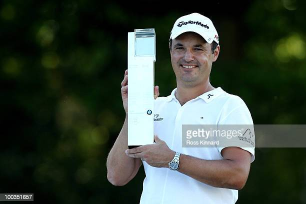 Simon Khan of England poses with the trophy following his victory at the end of the final round of the BMW PGA Championship on the West Course at...