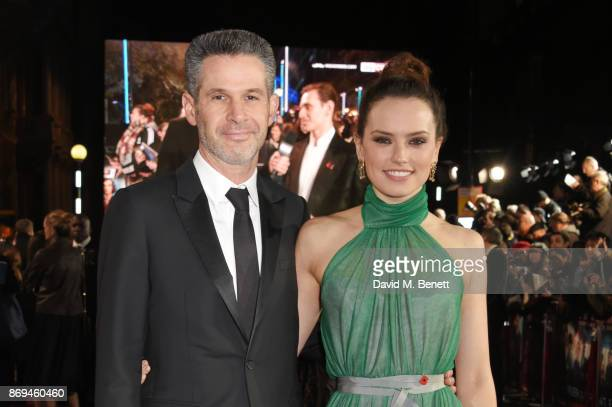 Simon Kinberg and Daisy Ridley attend the World Premiere of 'Murder On The Orient Express' at The Royal Albert Hall on November 2 2017 in London...