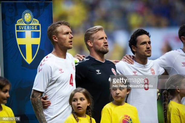 Simon Kjaer Kasper Schmeichel and Thomas Delaney of Denmark ahead of the International Friendly match between Sweden and Denmark at Friends Arena on...