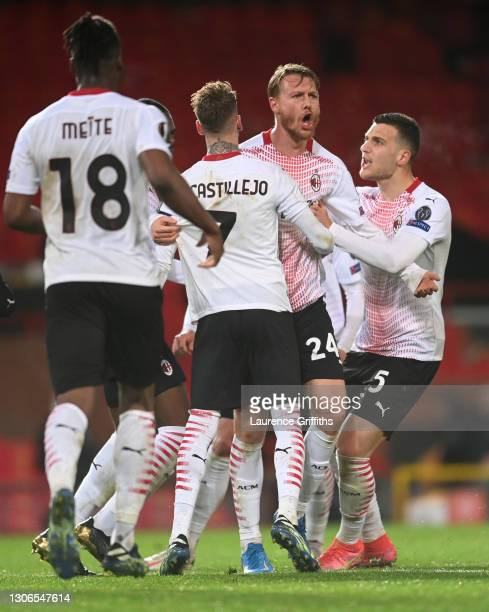 Simon Kjaer of A.C. Milan celebrates with teammates Samu Castillejo and Diogo Dalot after scoring their team's first goal during the UEFA Europa...