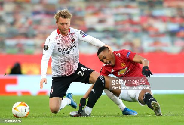 Simon Kjaer of AC Milan takes down Anthony Martial of Manchester United during the UEFA Europa League Round of 16 First Leg match between Manchester...