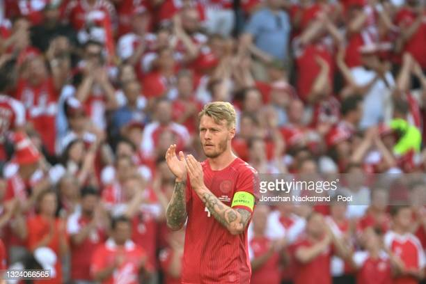 Simon Kjaer of Denmark applauds as the ball is kicked out of play in the tenth minute followed by a minute of applause in support of Denmark...