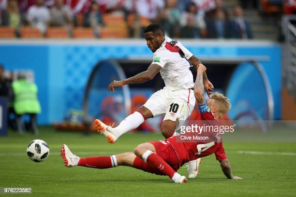 Simon Kjaer of Denmark challenges Jefferson Farfan of Peru during the 2018 FIFA World Cup Russia group C match between Peru and Denmark at Mordovia...