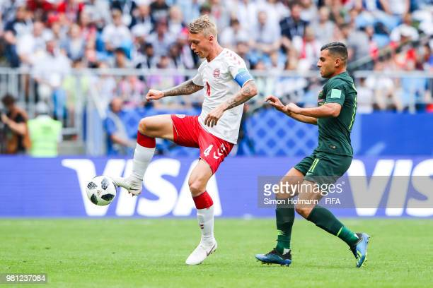 Simon Kjaer of Denmark is challenged by Andrew Nabbout of Australia during the 2018 FIFA World Cup Russia group C match between Denmark and Australia...