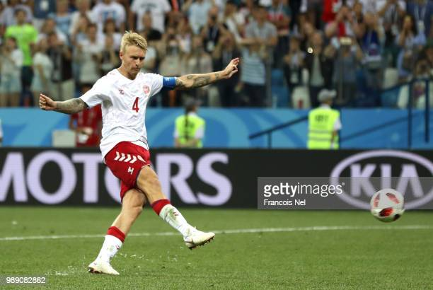Simon Kjaer of Denmark scores his team's second penalty in the penalty shoot out during the 2018 FIFA World Cup Russia Round of 16 match between...