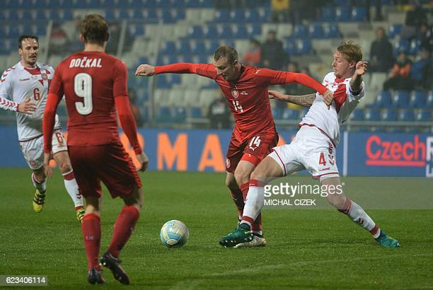 Simon Kjaer of Denmark vies for a ball with Michael Krmencik of Czech Republic during the friendly football match Czech Republic vs Denmark in Mlada...