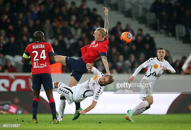 Simon Kjaer of Lille and Alexi Peuget of Reims in action during the french Ligue 1 match between LOSC Lille and Stade de Reims at the Grand Stade...