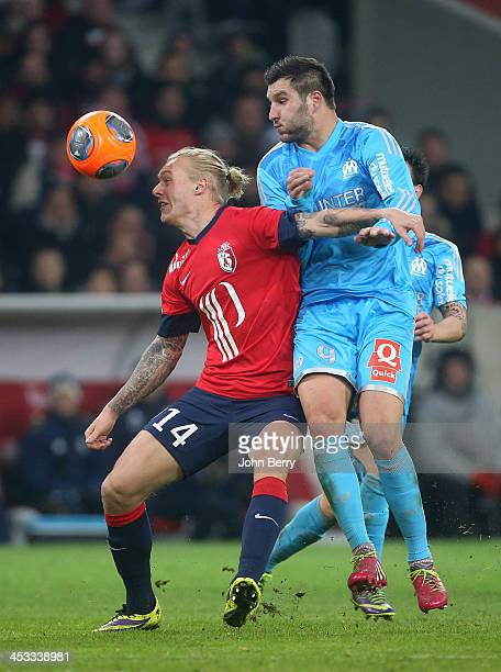 Simon Kjaer of Lille and AndrePierre Gignac of OM in action during the French Ligue 1 match between Lille OSC and Olympique de Marseille OM at the...