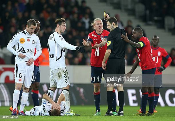 Simon Kjaer of Lille receives a yellow card from referee Alexandre Castro during the french Ligue 1 match between LOSC Lille and Stade de Reims at...