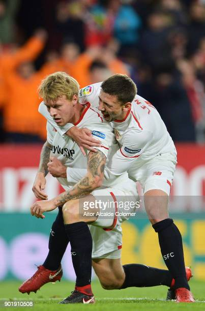Simon Kjaer of Sevilla FC celebrates with his teammates Clement Lenglet of Sevilla FC after scoring his team's second goal during the La Liga match...