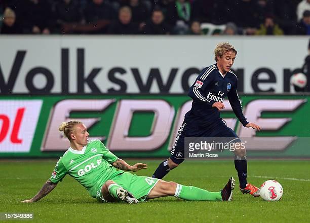 Simon Kjaer of Wolfsburg and Per Skjelbred of Hamburg battle for the ball during the Bundesliga match between VfL Wolfsburg and Hamburger SV at...