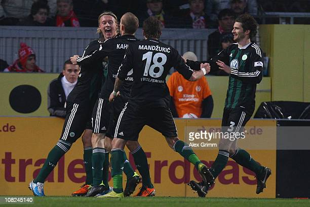 Simon Kjaer of Wolfsburg celebrates his team's first goal with team mates during the Bundesliga match between FSV Mainz 05 and VfL Wolfsburg at...