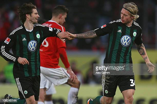 Simon Kjaer of Wolfsburg celebrates his team's first goal with team mate Arne Friedrich during the Bundesliga match between FSV Mainz 05 and VfL...