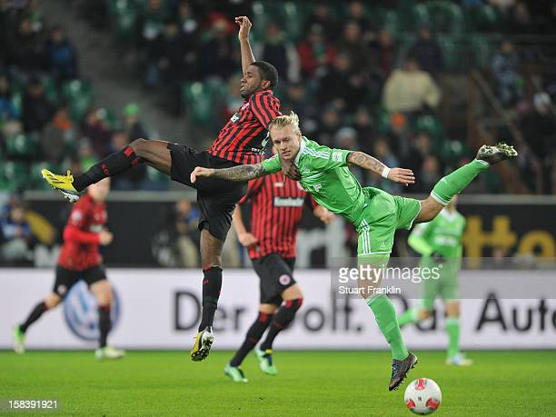 Simon Kjaer of Wolfsburg is challenged by Olivier Occean of Frankfurt during the Bundesliga match between VfL Wolfsburg and Eintracht Frankfurt at...