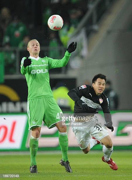 Simon Kjaer of Wolfsburg is challenged by Shinji Okazaki of Stuttgart during the Bundesliga match between VfL Wolfsburg and VfB Stuttgart at...