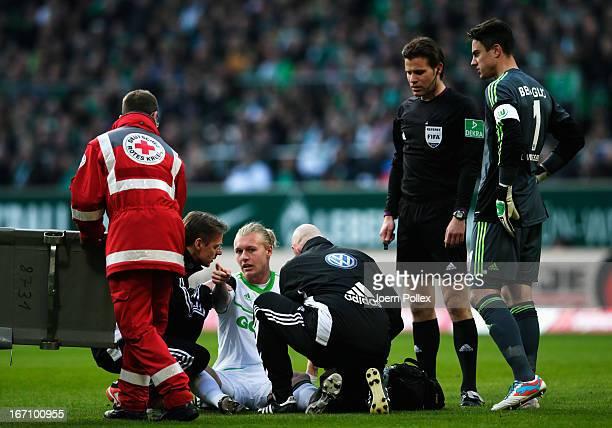 Simon Kjaer Wolfsburg is seen injured during the Bundesliga match between SV Werder Bremen and VfL Wolfsburg at Weser Stadium on April 20 2013 in...