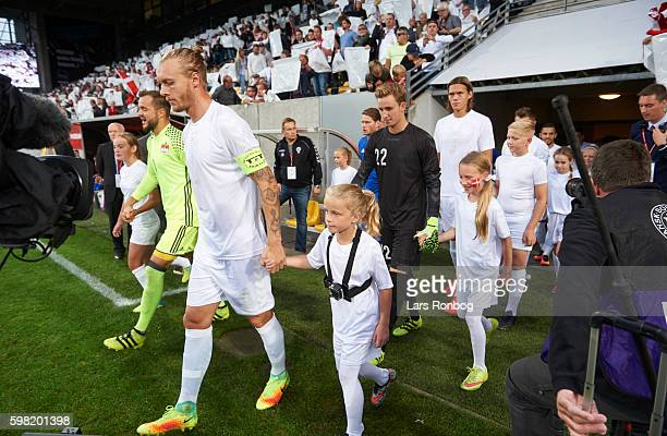 Simon Kjar and Frederik Ronnow of Denmark leads his team on to the pitch prior to the international friendly match between Denmark and Liechtenstein...