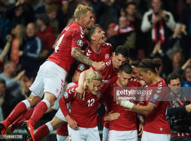 Simon Kjar Jens Stryger Larsen Andreas Christensen Kasper Dolberg Yssuf Poulsen and Pierre Emile Hojbjerg of Denmark celebrate after scoring their...