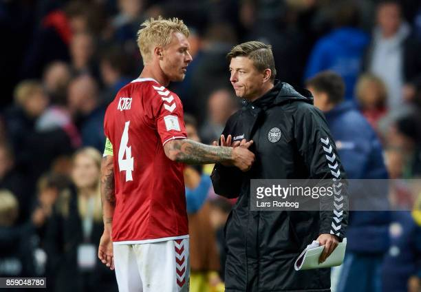 Simon Kjar of Denmark and Jon Dahl Tomasson assistant coach of Denmark shake hands after the FIFA World Cup 2018 qualifier match between Denmark and...