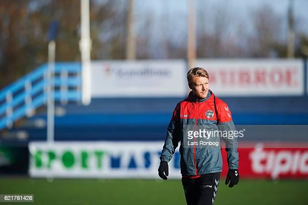 Simon Kjar walks on to the pitch prior to the Denmark training session at Gelsingor Stadion on November 8 2016 in Helsingor Denmark